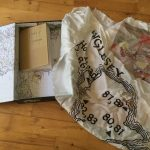 library of pilgrimage Sue Porter's box made posthumously by davina Kirkpatrick and Glenn Hall, showing maps, accessibility issues  and standing stones on Anglesey