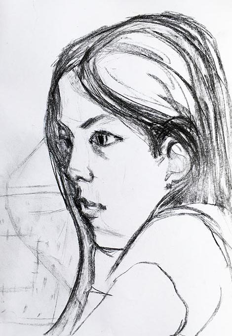 A portrait format drawing of a child in charcoal on paper, by Nina Packer. The drawing is a close up of her head, she is facing our left, watching Worzel Gummidge on T.V. The charcoal is home made using willow, this drawing is from the first National Lockdown.