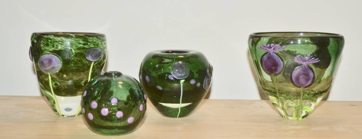 Selection of green Siddy Langley vases depicting alliums in the garden